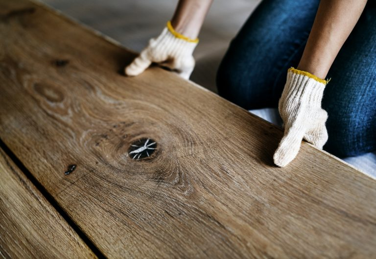 Man installing wooden floor